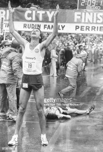 Rod Dixon from New Zealand gives thanks for slim victory in New York City Marathon which left secondplace Geoff Smith in state of collapse