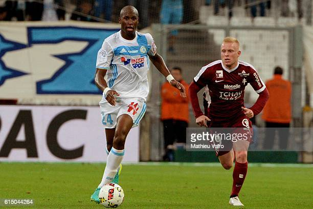 Rod FANNI of Marseille and Florent MOLLET of Metz during the Ligue 1 match between Olympique de Marseille and FC Metz at Stade Velodrome on October...