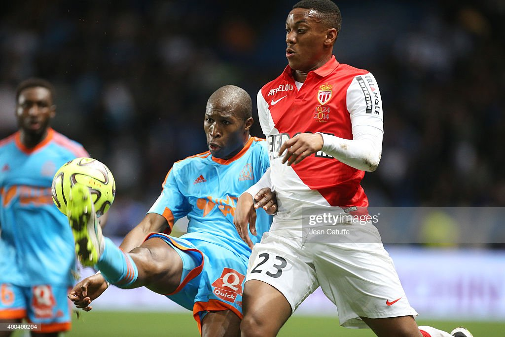 Rod Fanni of OM and Anthony Martial of Monaco in action during the French Ligue 1 match between AS Monaco FC v Olympique de Marseille OM at Stade Louis II on December 14, 2014 in Monaco.
