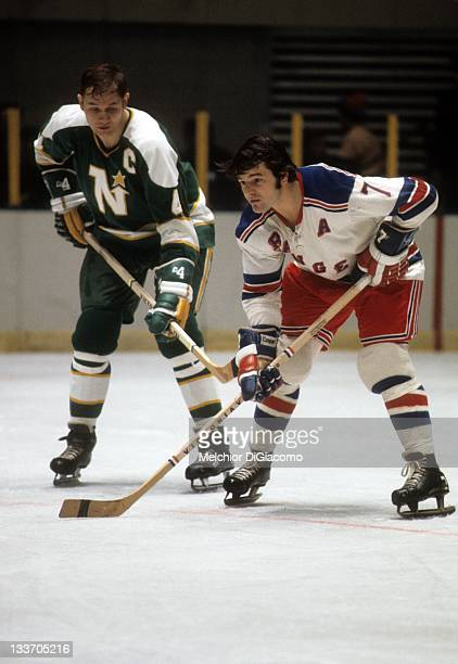 Rod Gilbert of the New York Rangers and Ted Harris of the Minnesota North Stars wait for the faceoff during their game circa 1972 at the Madison...