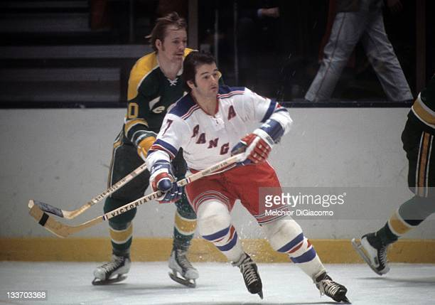 Rod Gilbert of the New York Rangers skates on the ice during an NHL game against the California Golden Seals circa 1973 at the Madison Square Garden...