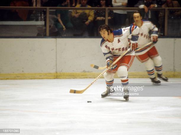 Rod Gilbert of the New York Rangers skates with the puck during an NHL game in February 1972 at the Madison Square Garden in New York New York