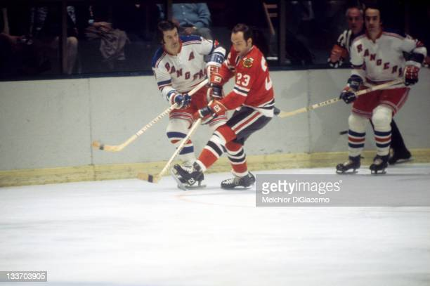 Rod Gilbert of the New York Rangers vies with Christian Bordeleau of the Chicago Blackhawks during their game circa 1972 at the Madison Square Garden...