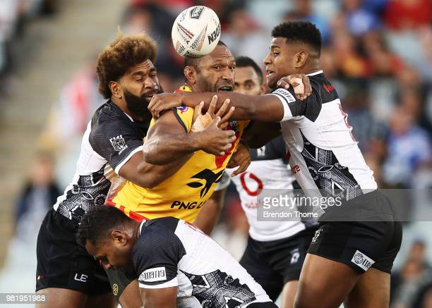 Rod Griffin of PNG is tackled by the Fijian defence during the 2018 Pacific Test Invitational match between Fiji and Papua New Guinea at Campbelltown...