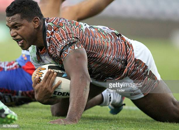 Rod Jensen of the Goannas scores a try during the NRL trial match between the Newcastle Knights and the First Nations Goannas at Hunter Stadium on...