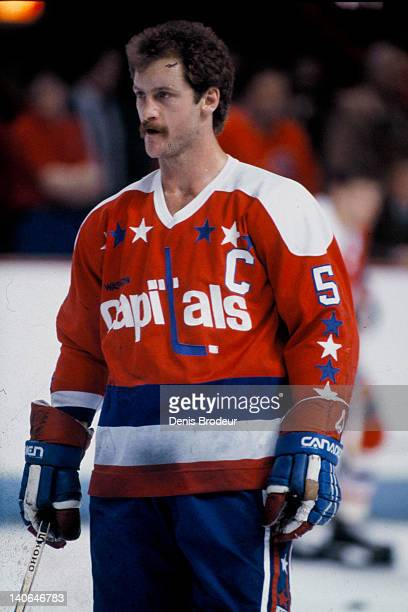 Rod Langway of the Washington Capitals looks on during warmups before a game against the Montreal Canadiens Circa 1980 at the Montreal Forum in...