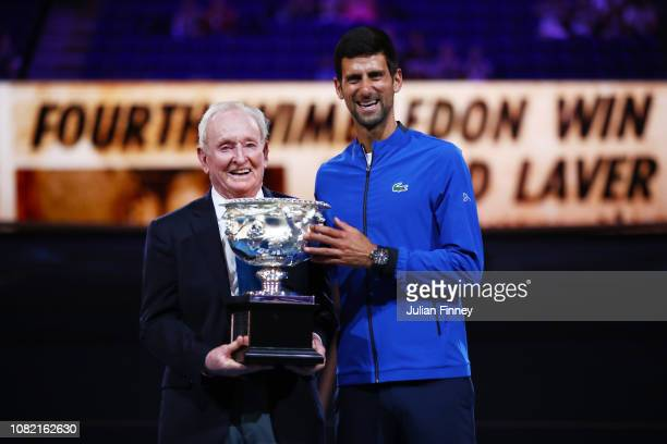 Rod Laver and Novak Djokovic pose with the Norman Brookes Challenge Cup during the 50th anniversary celebration for Australian Open and Rod Laver's...