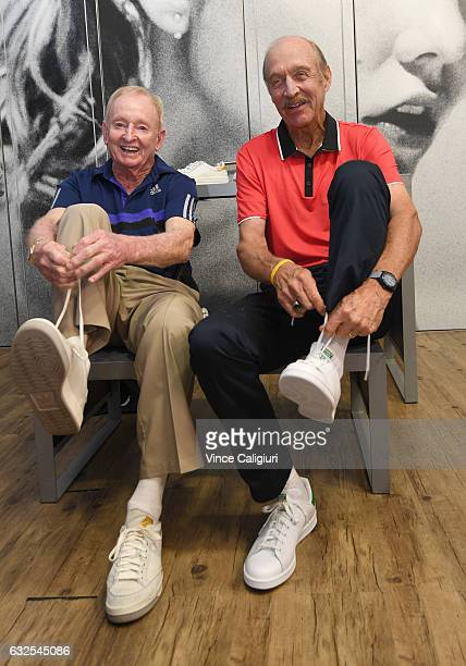 Rod Laver and Stan Smith pose with the adidas shoes named and designed in their honour at the adidas store at Grand Slam Oval during day nine of the...