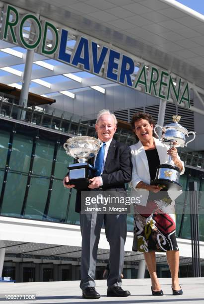 Rod Laver holds the Norman Brookes Challenge Cup and Evonne Goolagong Cawley holds the Daphne Akhurst Memorial Cup as they open day one of the 2019...