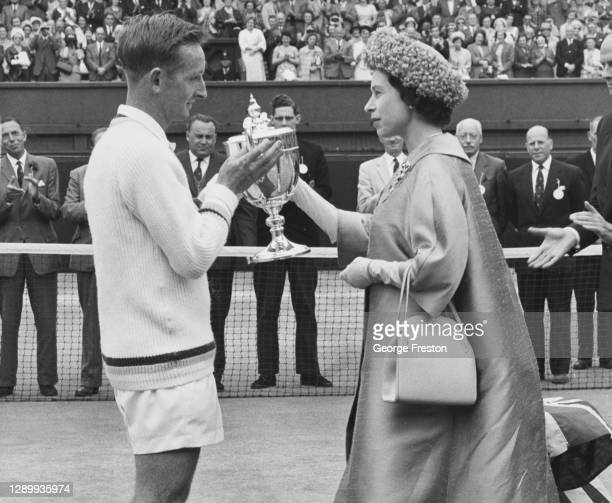 Rod Laver of Australia is presented with the Gentlemen's Singles Trophy by HRH Queen Elizabeth II after defeating compatriot Martin Mulligan in the...