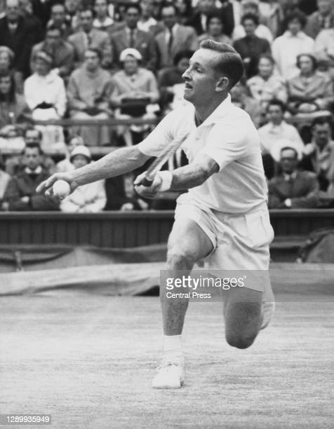 Rod Laver of Australia makes a forehand volley return against Barry MacKay during their Men's Singles Semi Final match at the Wimbledon Lawn Tennis...