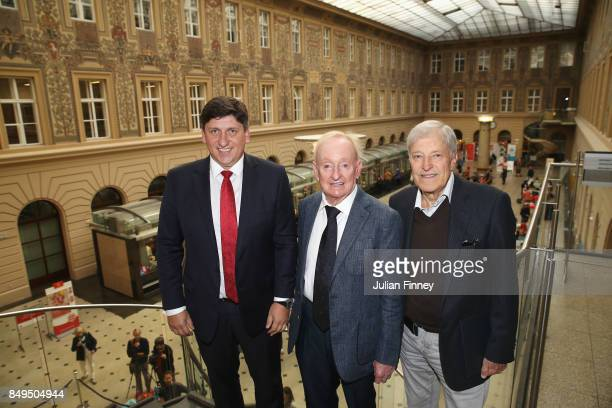 Rod Laver of Australia poses after unveiling a commemorative stamp with Martin Elkan Director General of the Czech Post and former Czech player Jan...