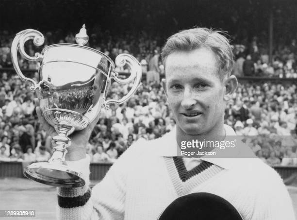 Rod Laver of Australia with the Gentlemen's Singles Trophy after defeating compatriot Martin Mulligan in the Men's Singles Final match at the...