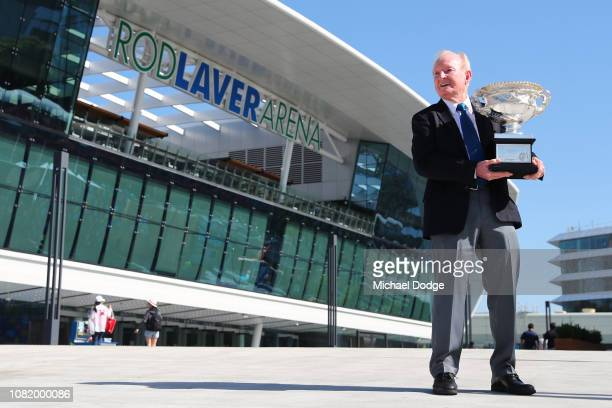 Rod Laver poses with the Norman Brookes Challenge Cup during the Australian Open trophy arrival and Welcome to Country ceremony on day one of the...