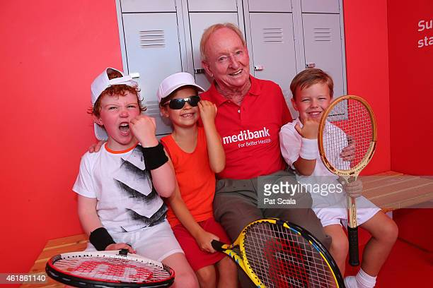 Rod Laver poses with young fans during the 2015 Australian Open at Melbourne Park on January 21 2015 in Melbourne Australia