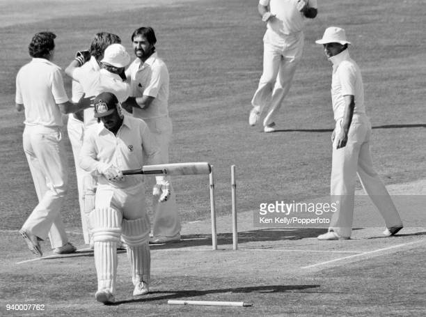 Rod Marsh of Australia walks off the field after being bowled by Ian Botham of England for 4 runs during the 4th Test match between England and...