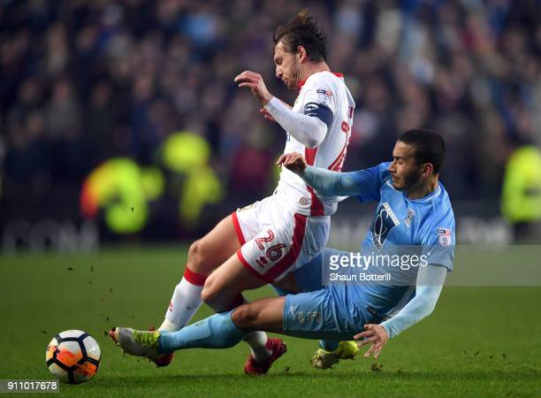 Rod McDonald of Coventry City tackles Alex Gilbey of Milton Keynes Dons during The Emirates FA Cup Fourth Round match between Milton Keynes Dons and...