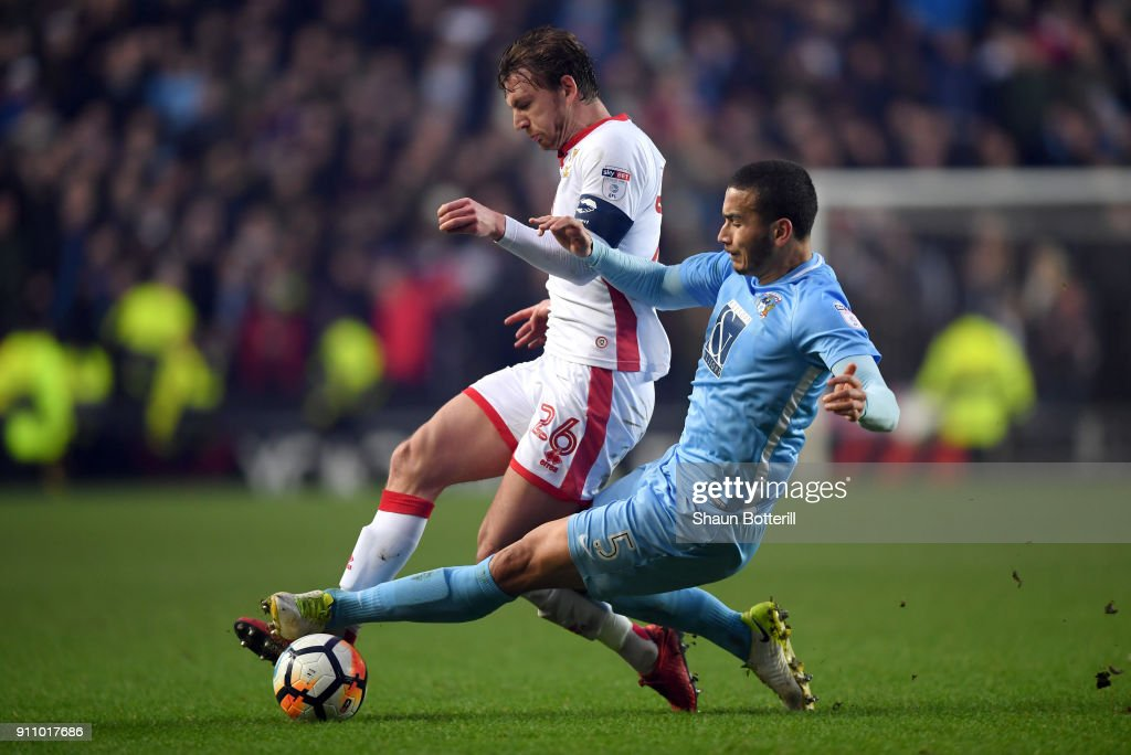 Rod McDonald of Coventry City tackles Alex Gilbey of Milton Keynes Dons during The Emirates FA Cup Fourth Round match between Milton Keynes Dons and Coventry City at Stadium mk on January 27, 2018 in Milton Keynes, England.
