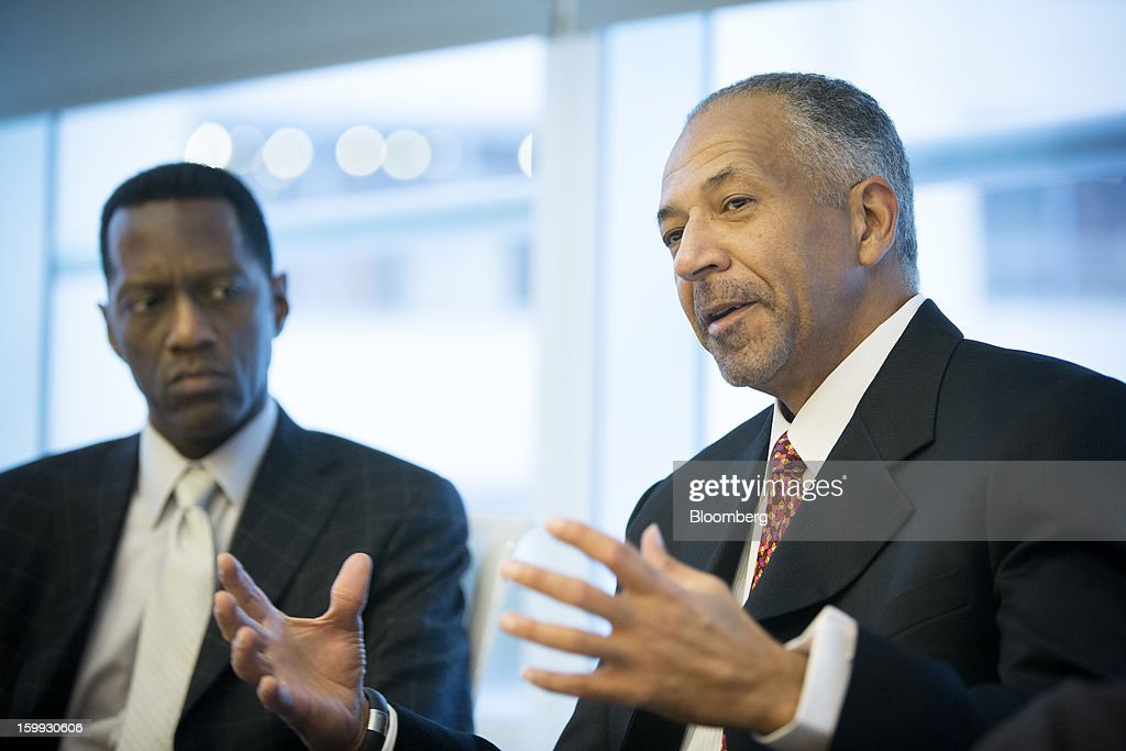 Rod O'Neal, chief executive officer of Delphi Automotive Plc, right, speaks during an interview in New York, U.S., on Wednesday, Jan. 23, 2013. Delphi, based in Troy, Michigan, is a former parts unit of General Motors Co. Photographer: Scott Eells/Bloomberg via Getty Images