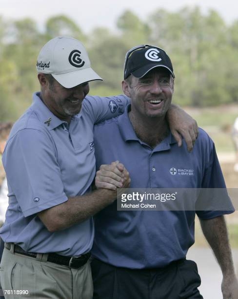 Rod Pampling and Jerry Kelly celebrate winning on the 18th hole after the third and final round of the Merrill Lynch Shootout at the Tiburon Golf...