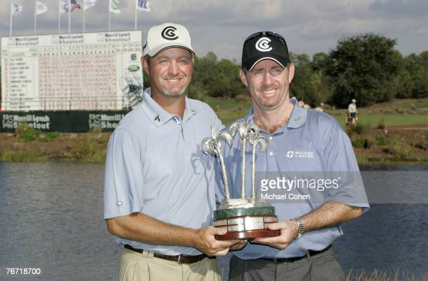 Rod Pampling and Jerry Kelly with the trophy after the third and final round of the Merrill Lynch Shootout at the Tiburon Golf Club in Naples,...