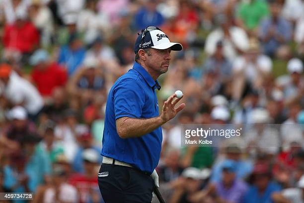 Rod Pampling of Australia aknowledges the crowd on the 18th hole during day four of the 2014 Australian Open at The Australian Golf Course on...