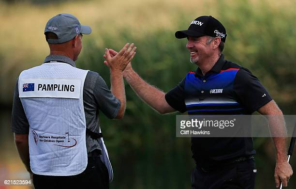 Rod Pampling of Australia celebrates with his caddie Brendan Woolley after putting for birdie to win on the 18th green during the final round of the...