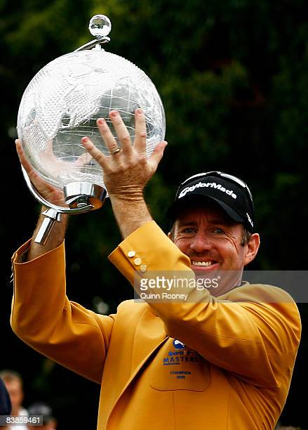Rod Pampling of Australia raises the trophy after winning the 2008 Australian Masters at Huntingdale Golf Club on November 30, 2008 in Melbourne,...