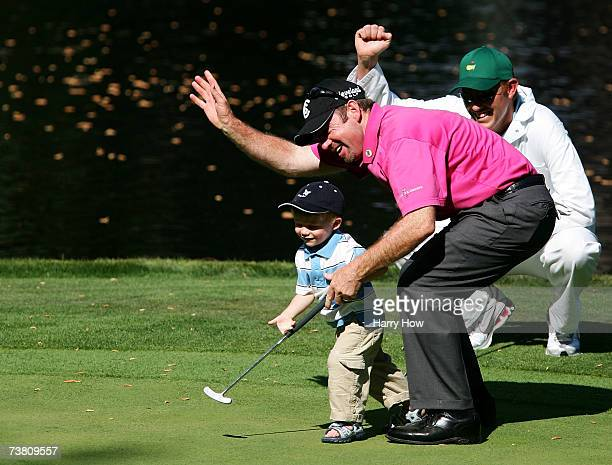 Rod Papmling of Australia celebrates with his son Samuel on the ninth green during the Par3 contest prior to the start of The Masters at the Augusta...