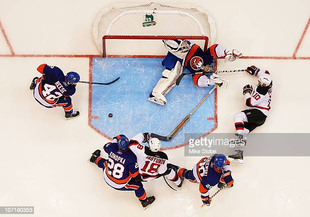 Rod Pelley of the New Jersey Devils is denied by goaltender Rick DiPietro of the New York Islanders on November 26, 2010 at Nassau Coliseum in...