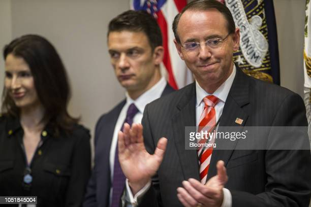 Rod Rosenstein deputy attorney general applauds during a signing ceremony in the Roosevelt Room of the White House in Washington DC US on Wednesday...