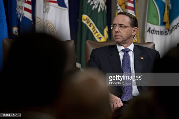 Rod Rosenstein deputy attorney general listens during an event on actions to combat the opioid crisis in the Great Hall at the Department of Justice...