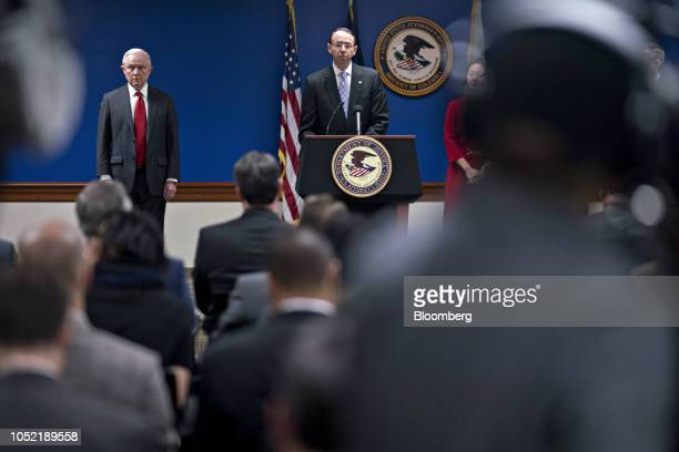 Rod Rosenstein deputy attorney general speaks as Jeff Sessions US attorney general left listens during a news conference at the US Attorney's Office...
