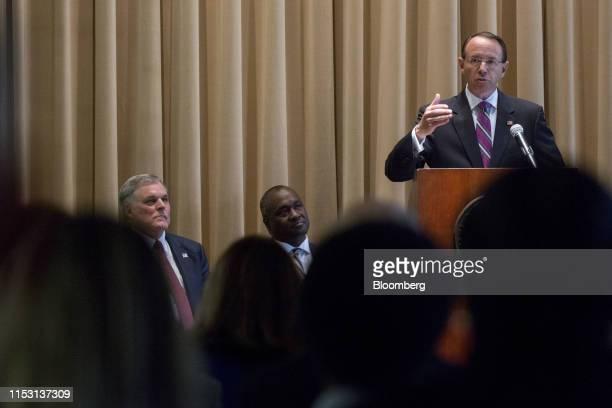 Rod Rosenstein, former deputy Attorney General, speaks as Charles Rettig, commissioner of the Internal Revenue Service , left, and Eric Hilton,...