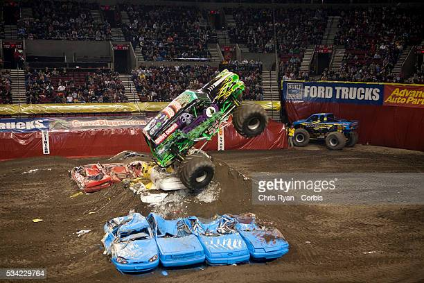 Rod Schmidt and Grave Digger roll over during the freestyle portion of a Monster Jam event at Rose Garden arena in Portland