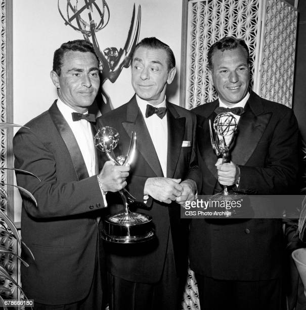 Rod Serling Eddie Cantor and Paul Monash pose for a photo at the 10th Annual EMMY Awards presented April 15 1958 at the Coconut Grove in Hollywood CA...