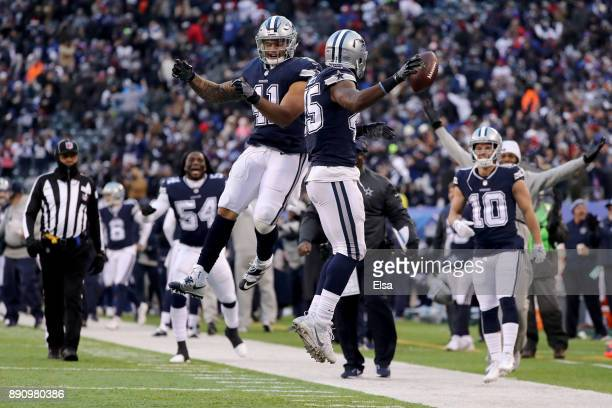 Rod Smith of the Dallas Cowboys celebrates with Keith Smith after scoring an 81 yard touchdown against the New York Giants during the fourth quarter...