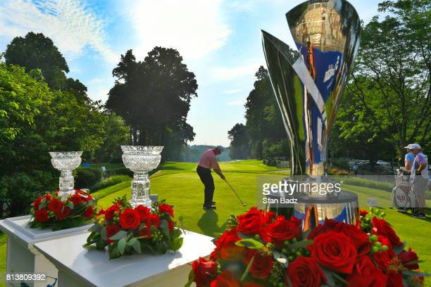 Rod Spittle hits a tee shot with the Charles Schwab Cup and the Constellation SENIOR PLAYERS Championship trophies displayed on the first hole during...