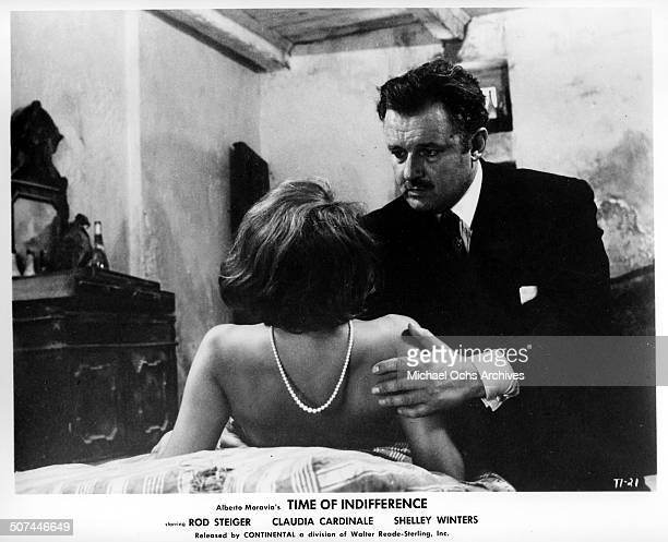 Rod Steiger grabs Claudia Cardinale in a scene from the movie 'Time of Indifference' circa 1964