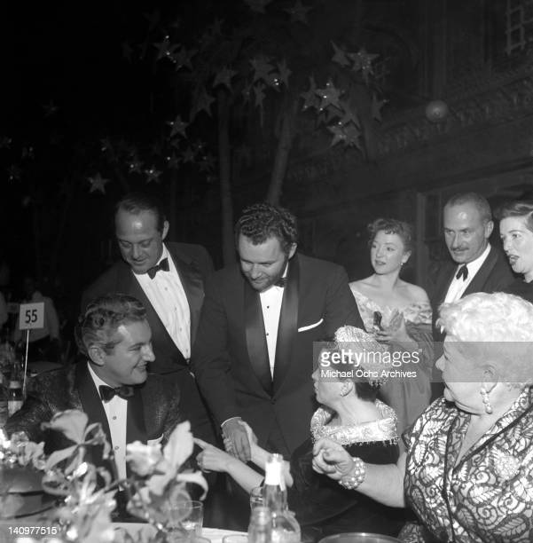 Rod Steiger greets actress and singer Judy Garland as pianist Liberace and comedienne Sophie Tucker look on actor Keenan wynn is standing to the...