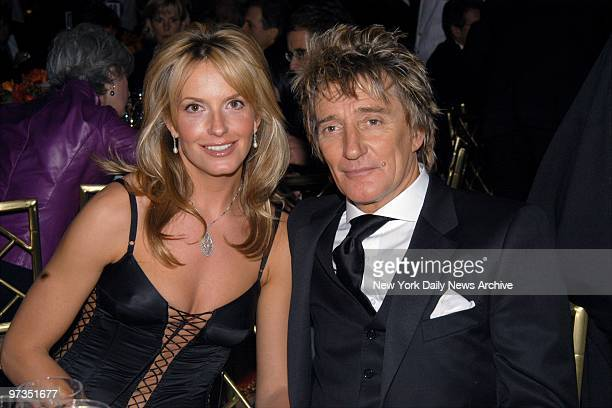 Rod Stewart and girlfriend Penny Lancaster are on hand during a preGrammy party in the Grand Ballroom of the Regent Wall St Hotel The bash celebrated...