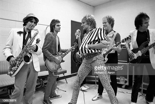 Rod Stewart and his band warm up backstage prior to his concert at the Forum in Los Angeles in December 1981 LR Jimmy Zavala Wally Stocker Robin Le...