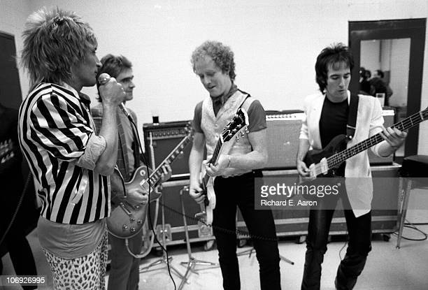 Rod Stewart and his band warm up backstage prior to his concert at the Forum in Los Angeles in December 1981 LR Rod StewartWally Stocker Jim Cregan...