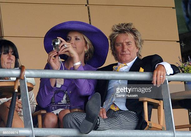 Rod Stewart and Penny Lancaster watch the races from a balcony on Ladies Day of Royal Ascot at Ascot Racecourse on June 18 2009 in Ascot England