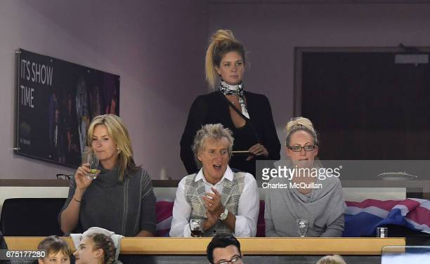 Rod Stewart and wife Penny Lancaster and Rachel Hunter celebrate with family members during the Ice Hockey Division 1B World Championship event at...