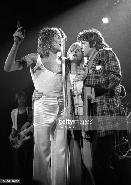 Rod Stewart of The Faces with Linda and Paul McCartney performing on stage at Lewisham Odeon London 18 November 1974