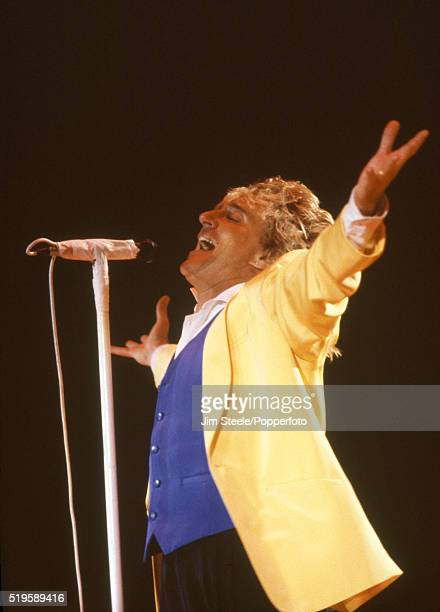 Rod Stewart performing on stage at Wembley Stadium in London on the 15th June, 1991.