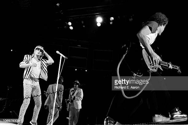Rod Stewart performs live on stage with guitarist Jim Cregan at the Forum in Los Angeles in December 1981