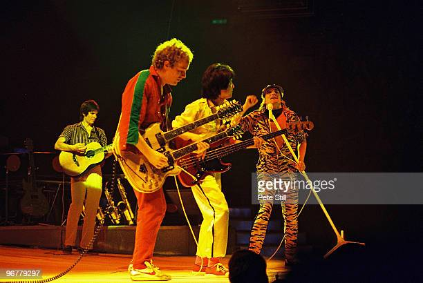 Rod Stewart performs on stage with band members Jim Cregan and Phil Chen at Wembley Arena on December 3rd 1980 in London United Kingdom