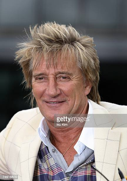 Rod Stewart poses with a 30 foot guitar for the openning of the Summer Exhibition Gibson Guitartown London at More London on June 26 2007 in London...